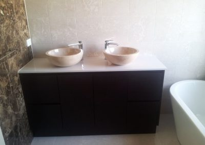 Dual marble sinks and birch vanity