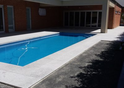 Tiling around Swimming Pool - 600x600 Salt & Pepper Granite Tiles