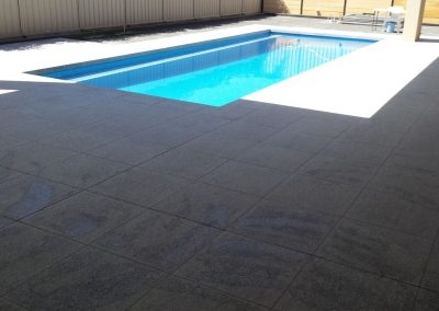 Tiling around Swimming Pool - (600x600) Salt & Pepper Granite Tiles